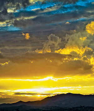 A typical sunset looking down from the  San Jacinto Mountains to the valleys below.  Photo by Gina Genis