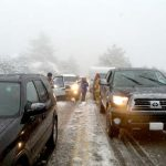 On Friday, April 13, Highway 243 turned into a parking lot as unprepared motorists try to make their way up the mountain in the midst of the snowstorm. Locals scratched their heads as people try to pass the already waiting vehicles.      Photo by Shane Fender