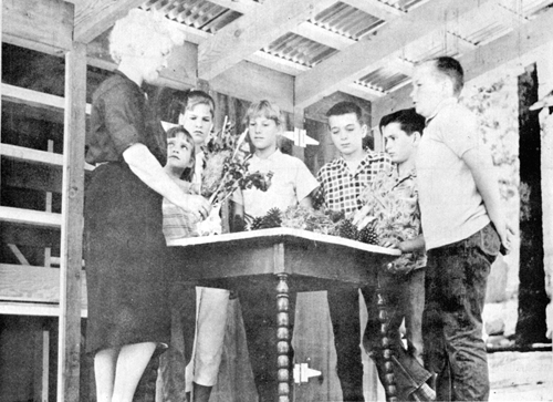 In this photo published June 22, 1962, summer school teacher Jo Oddus put to use the new outdoor science lab built by the Izaak Walton League. 	File photo
