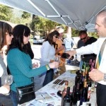 Wine connoisseurs are treated to fine wines from Bally Vineyard & Winery, one of the many wineries participating in Art Alliance of Idyllwild's 14th Annual Art & Wine Tasting. Photo by Cid Castillo
