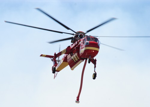 One of the numerous helicopters helping fight the Summit Fire Wednesday afternoon.