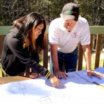 Yasmin Morales discusses the ICC with Robert Priefer, San Jacinto Mountain Community Center treasurer. Photo by Chris Trout