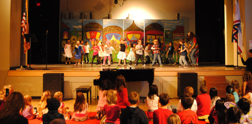 Mrs. Longbrook's first grade class performs a dance routine during Blast to the Past on Friday evening in the Idyllwild School gymnasium. The event is organized by the Associated Student Body. It is an opportunity for students to show off their talents and ASB to raise funds for the school's many annual field trips. Photo by Halie Johnson