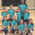 The Blue Dragons won the Town Hall Youth Volleyball championship in the 2-3 Division Friday night, May 3. Coach Lance Fogle stands behind. Front row: Ethan Teeguarden, Layton Teegaurden, Alexandra O'Neil and Tara Geisinger; back row: Aiden McLean, Fiona McMullen, Cody Fogle and Brooke Taylor.	Photo by Barbara Reese
