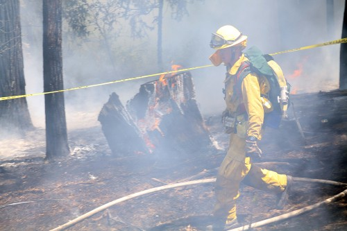 A firefighter at the Strong Fire Monday afternoon. Photo by Jenny Kirchner