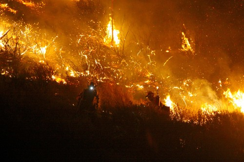 Firefighters battle the Silver Fire in Twin Pines Wednesday night. Photo by Jenny Kirchner