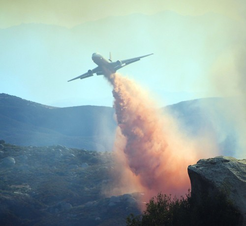 The DC-10 was called in within a hour after the Silver Fire started. Here it drops retardant near the Zen Center attempting to save the community.