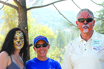 """The painted faces of, from left, Caroline Carlson, Pam Horvath and Steve Schill reflect the fun that was to be found at """"It's All About The Animals,"""" at Living Free Animal Sanctuary in 2008. Participants got to meet Living Free's dogs and cats, as well as some alpacas, and watch demonstrations of sheepherding and K-9 search and rescue. File photo"""