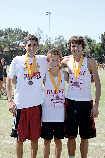Hemet High School's cross country team, with several Idyllwild members, placed at the Laguna Hills Invitational on Saturday, Sept. 14. Here, from left, are Jayden Emerson, a junior who placed third in his race, Micah Hitchcock, a freshman who finished fourth in his first high school meet, and Tanner Torrez, a junior who finished sixth in the junior boys race. Jayden, Tanner and Chad Schelly, not pictured, led the junior boys to a fourth-place finish against 14 other teams. Photo courtesy of Jessica Priefer