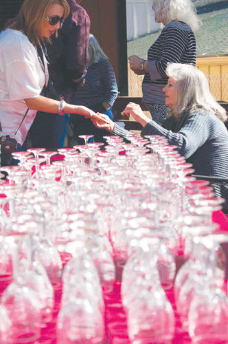 Volunteers ready the wine glasses for the Art Alliance of Idyllwild's 16th-annual Art Walk and Wine Tasting Saturday afternoon. The wine glass served as a ticket to the popular event.  Photo by John Pacheco