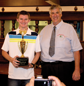 Above: Garrett Moyer received the President's Award from Grandfathers for Golf President Tony Viola at the organization's annual awards ceremony held Friday, Oct. 25, at the Golden Era Golf Course.  Photos by Jim Crandall