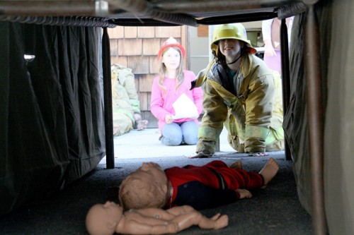 Chloe Lovett, 10, dresses in full turn-out gear prepared to save lives during open house.