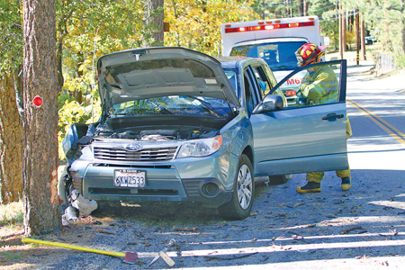 About 10:30 a.m. Friday, Oct. 25, Joan Gormley, 79, was traveling about 30 mph east on Pine Crest Avenue near Alderwood Street when she lost control of her Subaru Forester, crashing head on into a tree. Idyllwild Fire Department transported Gormley to Eisenhower Medical Center after she complained of pain to her right-side rib area. Photo by Jenny Kirchner