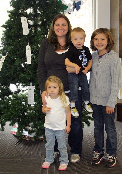 Idyllwild HELP Center Services Administrator Colleen Meyer and her kids, Peyton, 11, Brynnley, 4, and Caden, 2, set up Angel Christmas Trees at BBVA Compass Bank and in the back of the Idyllwild Library by the fireplace Monday morning. These trees have tags with presents or items that children are looking for that their families might not be able to afford this holiday season. Anyone in the community can take one of the tags and purchase the item at a store, returning the present with the tag to the Idyllwild HELP Center. This act of kindness may make that one child's holiday season a bright one. Photo by Jenny Kirchner