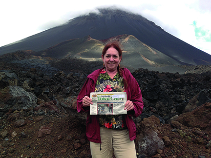 Marcia Krull and her Town Crier visit Pico do Fogo, an active volcano on the Cape Verde island of Fogo, located 350 miles off the coast of Western Africa.  Rising 9,281 feet above sea level, the volcano's last major eruption was in 1995. Krull was on her way to witness her third total solar eclipse, viewed on Nov. 3 from a small ship in the middle of the Atlantic Ocean.
