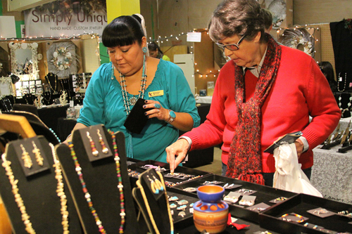 Barbara Hunt shops for jewelry at Melinda Pinto's booth during the 2013 Harvest Festival.             Photo by John Pacheco