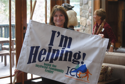 "Diane Cardinalli displays the ""I'm Helping Build the ICC"" flag to local business people attending this week's Idyllwild Community Center presentations.  Photo by J.P. Crumrine"