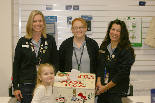Santa's helpers (from left) Sherry Kaufman, Kelsi Lehman and Christina Edwards help Kaysa Garcia-Lande (front) send her letter to Santa. Santa's box will be at the Post Office until noon Monday, Dec. 16. The Town Crier, with Santa's permission, will print some of the letters Santa receives from Idyllwild girls and boys in the Dec. 19 issue. Photo by Jay Pentrack