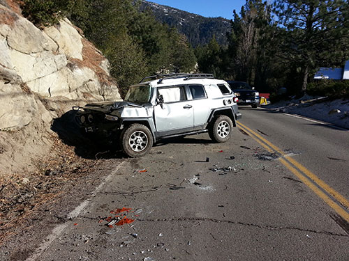 On Tuesday afternoon, Dec. 10, the Idyllwild Fire Department responded to a traffic collision on Highway 243 near the Strawberry Creek Bunkhouse. Upon arrival, firefighters found a Toyota FJ Cruiser blocking the northbound lane of Highway 243. Upon investigation, IFPD discovered that the vehicle had rolled off the private property directly above the highway after the owner exited the vehicle, possibly failing to engage the parking brake and/or take the vehicle out of gear. The vehicle landed on the highway, causing major damage to the vehicle, but the roadway was not damaged. IFPD personnel remained on-scene for less than an hour to direct traffic, while CHP investigated and the vehicle was removed from the scene. Photo courtesy Idyllwild Fire Chief Patrick Reitz