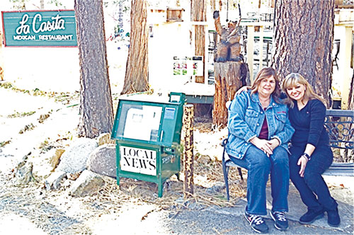 Yvonne Smith (left) is this week's photo contest winner, having correctly identified the entrance to La Casita restaurant on North Circle Drive from last week's photo. Sitting with her is Rebecca Garcia, the sister of La Casita owner Robert Garcia. Because of the carry-over prize, Smith wins four tickets to the Rustic Theatre — and there is a bonus this week as well: Garcia announced that he would be awarding a gift certificate to his restaurant as an additional prize to this week's winner. We had only two entrants this week with the correct answer to last week's photo contest: Smith and Laura Slattery are veteran Hill detectives, both having previously submitted correct answers to past contests, so one of them was bound to be a winner this time. Photo by Jack Clark