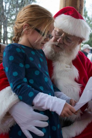 Ava Rose presents her Christmas list to Santa during the Tree Lighting Ceremony on Sunday, Dec. 1, in downtown Idyllwild. Photo by John Pacheco