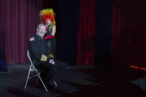 Idyllwild Fire Chief Patrick Reitz gets some personal attention from Sassy Ross at the Rustic Theatre's New Year's Eve Cabaret. The performers gave a special thank you to the firefighters and first responders involved in the Mountain Fire. Photo by John Pacheco