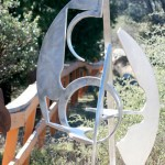 "One of Dore Capitani's early pieces on display in the Art Garden. Currently, Capitani's fascination is with ""swirly"" metal and powder-coating. See an example on page 4.        Photo by Jay Pentrack"