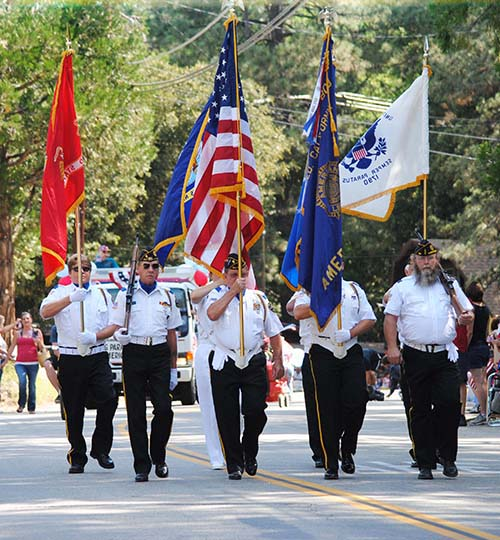 The Color Guard from American Legion Post 800 leads the Fourth of July parade down North Circle Drive last Thursday morning.Photo by J.P. Crumrine