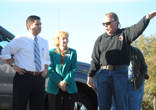 Congressman Dr. Raul Ruiz (left) listens to Norm Walker (right) of the Mountain Communities Fire Safe Council describe abatement along the fuel breaks near Inspiration Point. FSC Executive Director Edwina Scott (center) arranged for Ruiz's visit with FSC last Wednesday afternoon. Photo by J P Crumrine