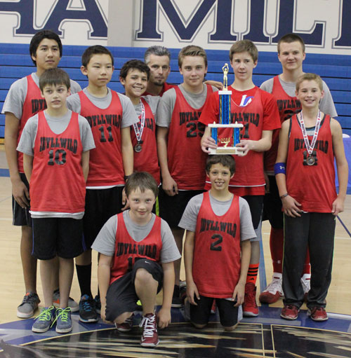 On Feb. 15, the Idyllwild School basketball teams participated in a middle school tournament in Anza at Hamilton High School. The boys team defeated both Cottonwood and Hamilton to win the tourney. Team members are (kneeling, from left) Stephan Carman and  Jake Maberry. In the middle row (front left) are Kevin Posey, Cody Espinosa, Ty Bride, Evan Biley, Noah Rutherford (holding trophy) and Zen Rose. Standing in the rear (from left) are Raul Pimentel, Coach Brennen Priefer and Chance Vladika.     Photo by Jessica Priefer