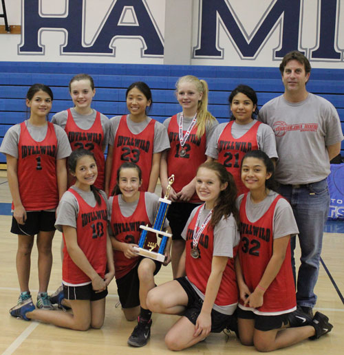 On Feb. 15, the Idyllwild School basketball teams participated in a middle school tournament in Anza at Hamilton High School. The girls team defeated both Hamilton and Cottonwood, holding both opponents to less than 10 points for the game. Team members kneeling in the front row are from leftMaggie McKimson, Payton Priefer (holding trophy), Amy McKimson and Destiny Mikroulis. Standing in the back row from left are Sidney Cruz, Miren Pino,  Abby See, Aubrey Crump, Sara Goins and Coach Tom Dillon.         Photo by Jessica Priefer