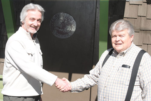 On his first day at Idyllwild Water District, Tom Lynch (left), the new general manager, shakes hands with Terry Lyons, who is retiring after more than 10 years with the district.   Photo by JP Crumrine