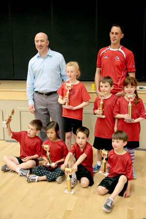 The kindergarten to third-grade division Red Ninjas team won its championship basketball game Friday night. The Red Ninjas (from left, back row) are Coach Bo Dagnall, Geneva Dagnall, Nathan Dunning, Kendra Collis and Coach Jason Sonnier.  In front (from left) are Carter Mclean, Meili Stroud, Tyler Sonnier and Silas Tiso. (Not pictured is Colby Sonnier.) Photo by Jenny Kirchner