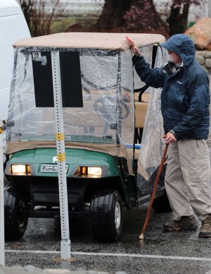 A little weather didn't stop this resident in his golf cart Friday afternoon. Photo by  Jenny  Kirchner