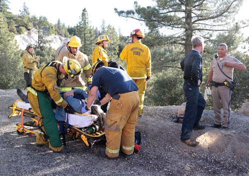 Shelby Deming, 58, of Banning, was traveling north on Highway 243 around 5 p.m. Saturday, March 15, when she lost control of her Silver Toyota FJ, plunging about 100 feet down an embankment near mile marker 10. The cause of the crash is unknown. According to California Highway Patrol Officer Ron Esparza, Deming didn't know how she lost control. Idyllwild Fire transported Deming to San Gorgonio Medical Center with minor injuries.Photo by Jenny Kirchner