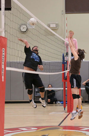 Silver Pines goes for a kill against Higher Grounds on Thursday night. Photo by Jenny Kirchner