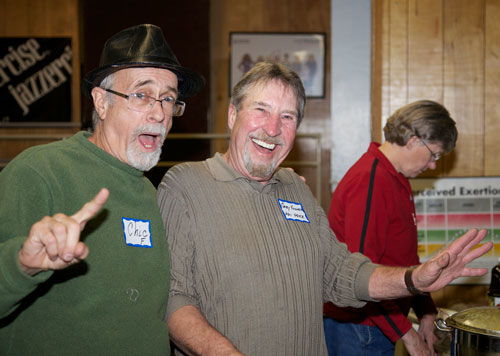 Chic Fojtik and Gary Kuscher, president of the Art Alliance of Idyllwild, enjoy the sociality of an old-fashioned, community event Friday at Town Hall, which AAI organized and promoted. Photo by Gina Genis