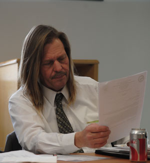 Ron Kammeyer, a member of the Idyllwild Historic Preservation District Local Review Board, studies a letter to the board during last week's meeting.       Photo by J.P. Crumrine