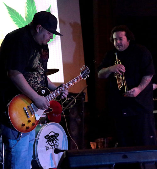 Eddie Morales (left) on guitar and Mike Silva (right) on vocals and trumpet, groove together to the music. Photos by Jenny Kirchner
