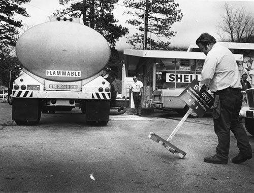 """How to be a hero. In February 1974, Gary Dencklau, proprietor of Idyllwild's Shell station, removed the """"Sorry"""" sign as he received his first delivery under the March gasoline allotment during the gas shortage of that time. Photo by Norwood Hazard, file photo"""
