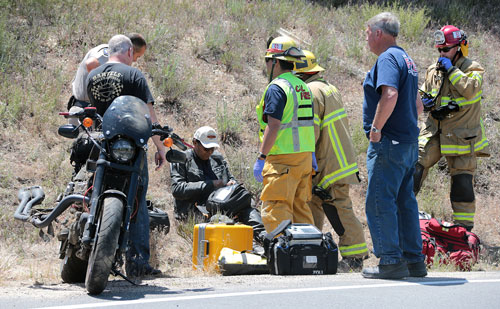 Above, according to California Highway Patrol Officer Mike Murawski, at about 1:15 p.m. Sunday,Alphonso Crespo, 57, of Bakersfield, crashed his 2011Harley Davidson XR 1200x while traveling westbound on Highway 74 just east of Highway 243. Crespo was transported by American Medical Response to a nearby hospital with minor injuries, complaining of left ankle pain. Photo by Jenny Kirchner