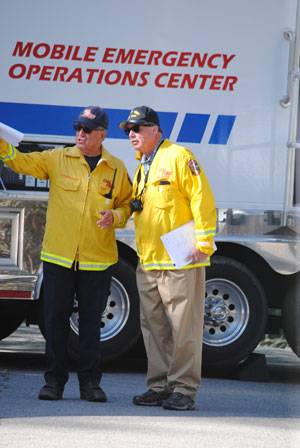 Riverside County Fire Chief John Hawkins (left) talks with County Executive Officer Jay Orr, who observed the drill from start to finish. Photo by J.P. Crumrine.