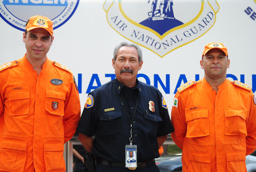 Two Brazilian fire officials, Major Moisés Alves Barcelos (left) and Commandante Alan Alexandre Araujo (right), observed the fire drill. Accompanying the Brazilian fire officials was Art Torrez of the California Emergency Management Agency. In addition, two Los Angeles County fire officials observed the exercise. Photo by J.P. Crumrine.