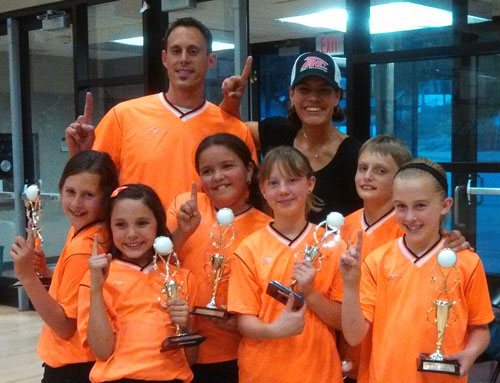 First-place winners in Town Hall Kids Volleyball Division B last week were the Orange Loco Unicorns. Back row, from left, Coaches Jason and Dawn Sonnier; front row, from left, Katelyn Sonnier, Grace McKimson, Jessica Ruelas, Matilda Terry, Toby Posey and Brooke Taylor. (Not shown was Preston Pino.)         Photo by Ginger Dagnall
