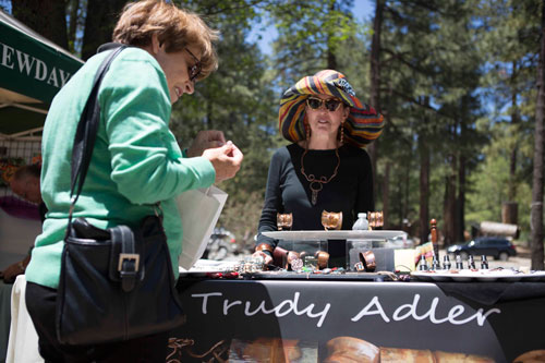 ART FAIR: Trudy Adler displays her hand-crafted, nature-themed jewelry at the first Art Alliance of Idyllwild's Second Saturday Art Fair of the season at the Idyllwild Community Center site on Saturday. The event runs through October.    Photo by John Pacheco