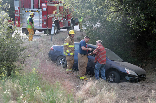 According to California Highway Patrol Officer Mike Murawski, at about 5:40 p.m. Monday, May 19,Rob Rutherford, 56 of Idyllwild, was traveling south on Highway 243 when he lost control of his 2007 Blue Honda Accord near mile marker 15, about 1.5 miles north of Lake Fulmor. The car careened off the road and down an embankment. Rutherford was uninjured, but was arrested by CHP Officer Murawski on suspicion of driving under the influence.   Photo by Jenny Kirchner