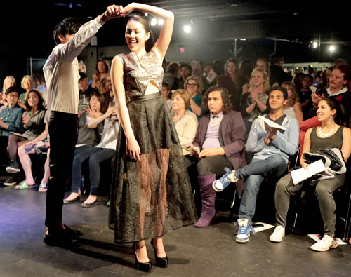 FASHION SHOW:  Howard Cheng (right) gives Chelsea Sik a spin during the Idyllwild Arts' Spring Fashion Show Friday night at Rush Hall on campus. Photo by Jenny Kirchne