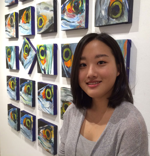 Dayeon Han stands in front of one of her works on display at the Idyllwild Arts Academy's Parks Exhibition Center.  Photo by Marshall Smith