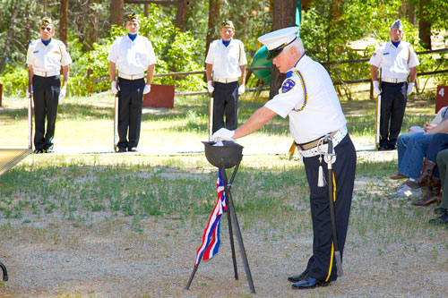 During the 2014 Memorial Day service at Idyllwild's American Legion Post 800 on Monday, Danny Richardson burns the names of the service members no longer alive. Photo by Gina Genis