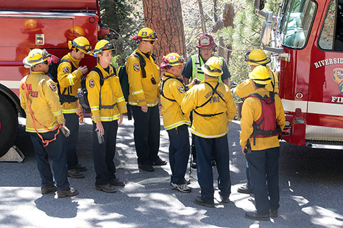 Fire personnel from Riverside County Fire prepare to rescue an injured rock climber who fell Monday afternoon, May 19. The team hiked in on Devil's Slide Trail from Humber Park. Photo by Jenny Kirchner